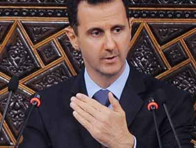 In this March 30, 2011 file photo released by the Syrian official news agency SANA, Syrian President Bashar Assad, addresses the Parliament, in Damascus, Syria. (AP Photo/SANA, File)