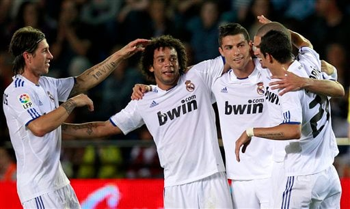 Real Madrid's Cristiano Ronaldo from Portugal, third left, is congratulated by teammate Sergio Ramos,left, Marcelo from Brazil , after scoring a goal against Villarreal during La Liga soccer match at the Madrigal stadium in Villarreal, Spain.