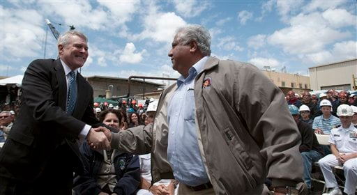 Navy Secretary Ray Mabus, left, shakes hands with the son of former labor leader Cesar Chavez, Paul Chavez.