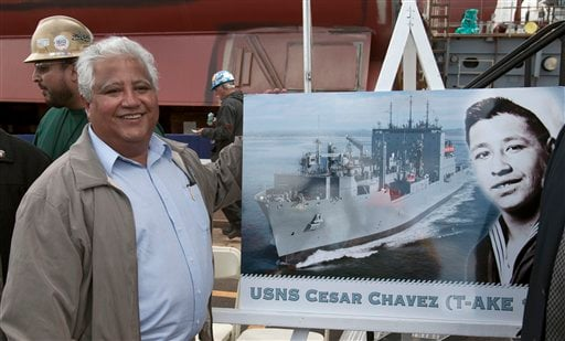Paul Chavez, the son of former labor leader Cesar Chavez poses for a picture alongside an image of his father during his stint in the Navy