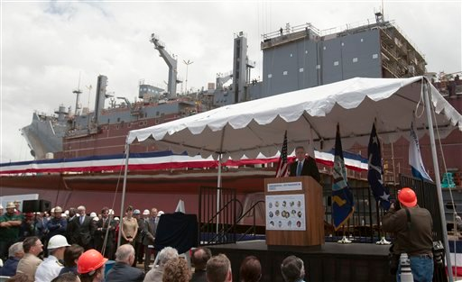Navy Secretary Ray Mabus, at podium, speaks during a naming ceremony for a new Navy ship at a shipyard Wednesday, May 18, 2011, in San Diego.