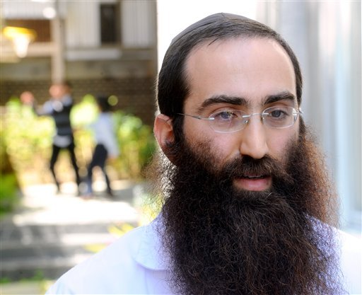 In this Sunday, May 15, 2011 photo, Rabbi Gil Leeds discusses a proposed ballot initiative banning circumcision shortly after performing a brit milah, a Jewish circumcision ceremony, in San Francisco.