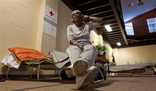 Flood victim Vivian Taylor-Wells sits on a cot at a Red Cross shelter in Vicksburg, Miss., Wednesday, May 18, 2011.