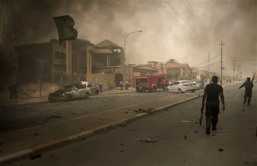 Iraqi security forces inspect the scene of a bombing in Kirkuk, 180 miles, or 290 kilometers, north of Baghdad, Iraq, Thursday, May 19, 2011. (AP Photo/Emad Matti)