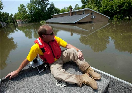 Deputy Mike Traxler views flooded homes in Vicksburg, Miss., Wednesday, May 18, 2011. (AP Photo/Dave Martin)