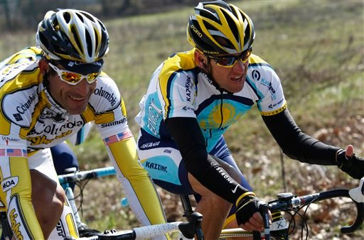 FILE - In this March 21, 2009 file phot, Lance Armstrong, right, of the United States, pedals with fellow-countryman George Hincapie, left, during the Milan-San Remo cycling classic, in San Remo, Italy.
