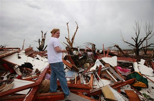 Shawna Neal looks through the rubble that used to be her home in Joplin, Mo., Monday, May 23, 2011.