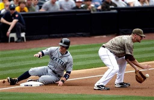 Seattle Mariners' Brendan Ryan, left, easily beats the throw to San Diego Padres third baseman Chase Headley while advancing from first in the second inning of a baseball game on May 22, 2011, in San Diego. (AP Photo/Lenny Ignelzi)