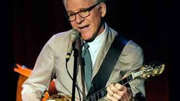 In this March 19, 2010 file photo, Steve Martin performs with the Steep Canyon Rangers band at Largo at the Coronet Theatre in Los Angeles. (AP Photo/Chris Pizzello, File)
