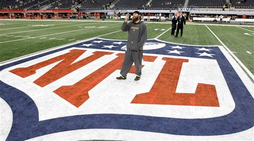 In this Feb. 6, 2011, file photo, Pittsburgh Steelers' Brett Keisel takes a photo on the field before NFL football's Super Bowl XLV between the Steelers and the Green Bay Packers in Arlington, Texas. (AP Photo/David J. Phillip, File)