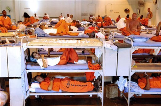 In this undated file photo released by the California Department of Corrections, inmates sit in crowded conditions at California State Prison, Los Angeles. (AP Photo/California Department of Corrections, File)