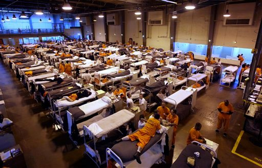 In this May 20, 2009 file photo, several hundred inmates crowd the gymnasium at San Quentin prison in San Quentin, Calif.