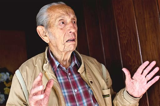 In this photo from Sunday, May 22, 2011, Christian radio host Harold Camping speaks outside of his home in Alameda, Calif.