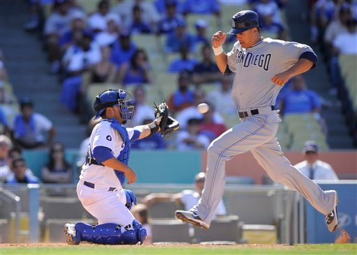 San Diego Padres' Will Venable, right, scores.