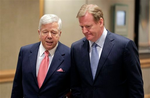 Robert Kraft, owner of the New England Patriots, left, talks with NFL Commissioner Roger Goodell.  (AP Photo/AJ Mast)