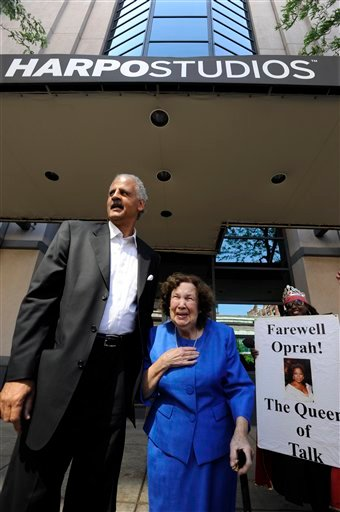 """Stedman Graham left, escorts Oprah's 4th grade teacher Mary Duncan out of Harpo Studios after the final taping of the """"Oprah Winfrey Show"""" after 25 years in Chicago, Tuesday, May 24, 2011. (AP Photo/Paul Beaty)"""
