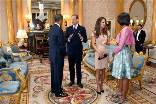 U.S. President Barack Obama, left, and first lady Michelle Obama, right, meet with Britain's Prince William and the Duchess of Cambridge, second left, at Buckingham Palace in London, Tuesday, May 24, 2011.