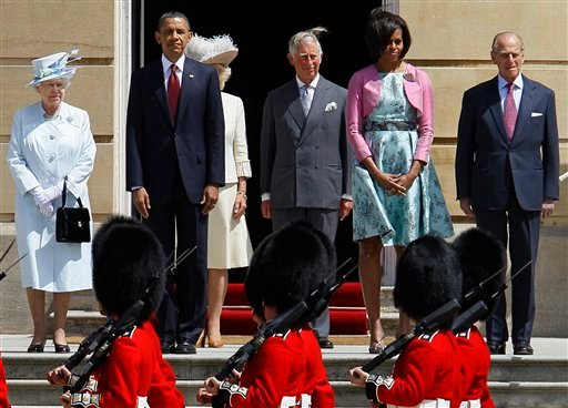 Britain's Queen Elizabeth II, left, U.S. President Barack Obama, 2nd left. Prince Charles, centre, U.S. first lady Michelle Obama, 2nd right, and Prince Philip take part in the official welcome ceremony outside Buckingham Palace.