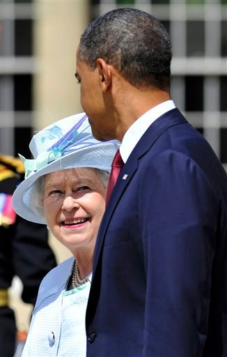 U.S. President Barack Obama and Britain's Queen Elizabeth attend the ceremony for the national anthems at Buckingham Palace in London Tuesday May 24, 2011.