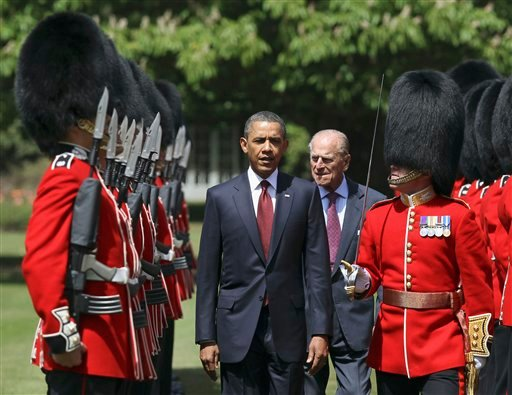 US President Barack Obama, center left, inspects the guard of honor 1st battalion Scots Guards with Britain's Prince Philip, center right, at Buckingham Palace in London.