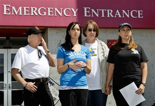 From left to right, David Stow, father, Bonnie Stow, sister, Erin Collins, sister, and Ann Stow, mother, of San Francisco Giants fan Bryan Stow, express thanks during a news conference at a hospital in San Francisco, Monday, May 23, 2011.