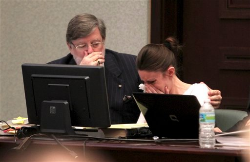 Attorney Cheny Mason, left, comforts Casey Anthony as she cries while listening to her defense counsel during opening statements at the Orange County Courthouse on Tuesday, May 24, 2011., in Orlando, Fla.