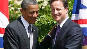 President Barack Obama and British Prime Minister David Cameron shake hands after their joint news conference at Lancaster House in London, Wednesday, May 25, 2011. (AP Photo/Charles Dharapak)