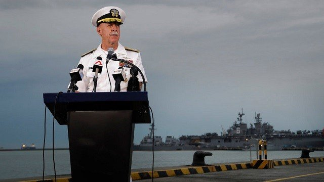 Commander of the U.S. Pacific Fleet, Scott Swift answers questions during a press conference with the USS John S. McCain.