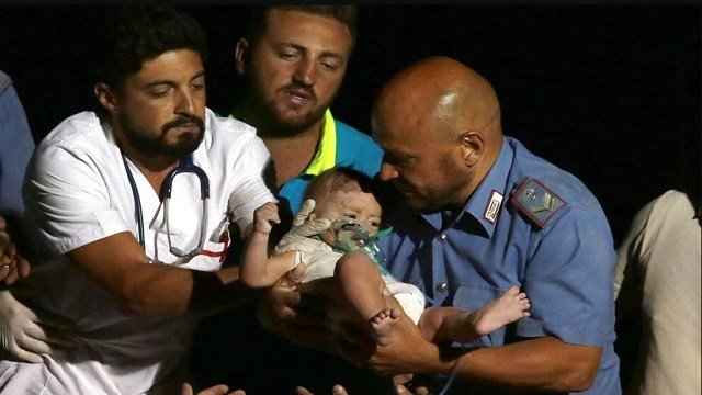 Rescuers pull out 7-month boy Pasquale from the rubble of a collapsed building in Casamicciola, on the island of Ischia, near Naples, Italy.