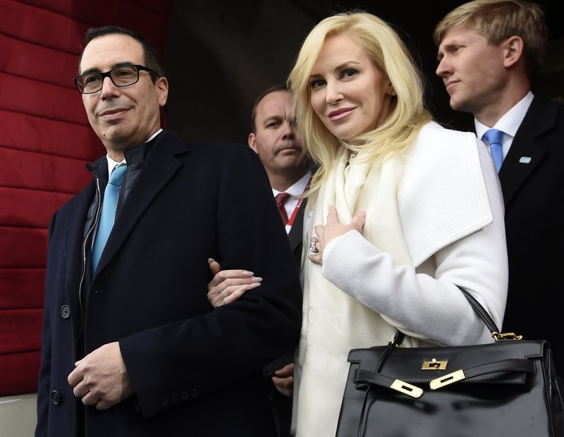 In this Friday, Jan. 20, 2017, file photo, then Treasury Secretary-designate Stephen Mnuchin and his then-fiancee, Louise Linton, arrive on Capitol Hill in Washington, for the presidential inauguration of Donald Trump.