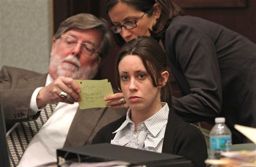 Casey Anthony, center, sits at the defense table with her attorneys Cheney Mason, left, and Lisabeth Fryer at the Orange County Courthouse in Orlando, Fla., Wednesday, May 25, 2011.