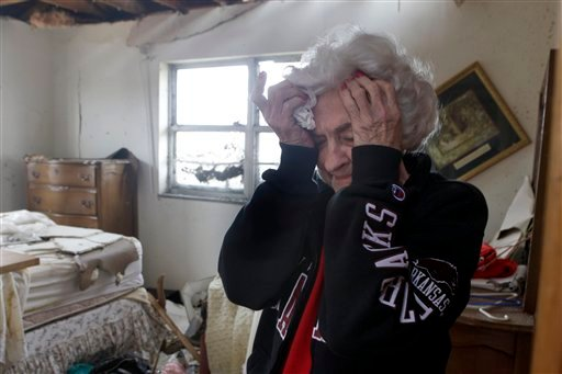 Florene Renfro, 85, breaks down as she goes through her damaged home Wednesday, May 25, 2011, in Joplin , Mo.