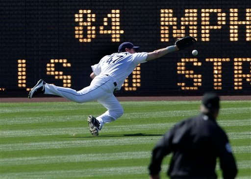 San Diego Padres left fielder Ryan Ludwick makes a diving attempt to catch a double off the bat of St. Louis Cardinals' Daniel Descalso in the second inning of a baseball game, Wednesday, May 25, 2011, in San Diego.