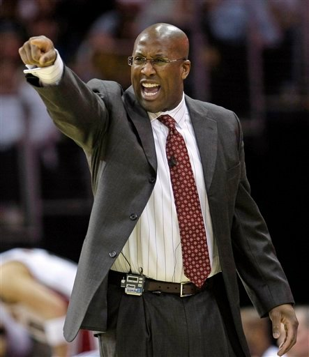 In this Feb. 18, 2010 file photo, then Cleveland Cavaliers head coach Mike Brown directs his team during an NBA basketball game against the Denver Nuggets in Cleveland.