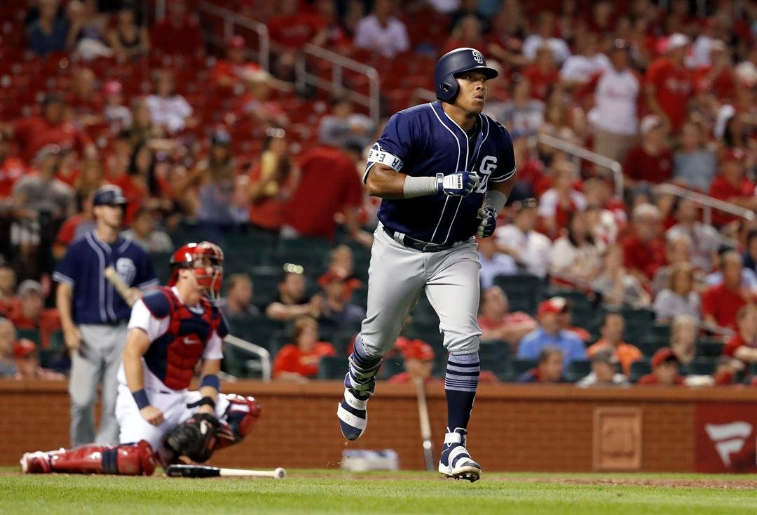 San Diego Padres' Yangervis Solarte, right, rounds the bases after hitting a two-run home run as St. Louis Cardinals catcher Carson Kelly, left, kneels at the plate during the eighth inning of a baseball game Tuesday, Aug. 22, 2017, in St. Louis. (AP Phot