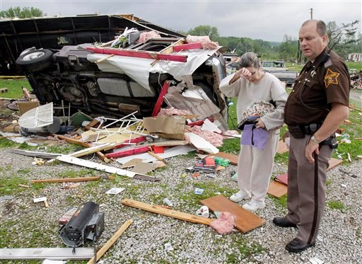 Marie Mason reacts after looking through items of a family member at a trailer park that was damaged following a severe storm in Bloomington, Ind., May 26, 2011. (AP Photo/Darron Cummings)
