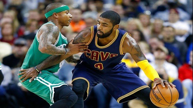 Cleveland Cavaliers' Kyrie Irving, right, looks to drive against Boston Celtics' Isaiah Thomas during the first half of an NBA basketball game in Cleveland.