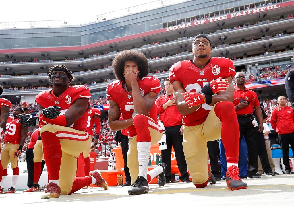 10/2/16, file photo: From left, 49ers outside linebacker Eli Harold, quarterback Colin Kaepernick, center, and safety Eric Reid kneel during the national anthem before game against the Cowboys in Santa Clara, CA. (AP Photo/Marcio Jose Sanchez, File)
