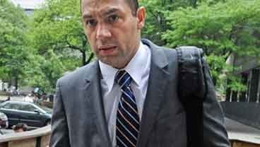 In this May 19, 2011 photo, Police officer Ken Moreno enters State Supreme court on the second day of jury deliberations in New York. (AP Photo/ Louis Lanzano)