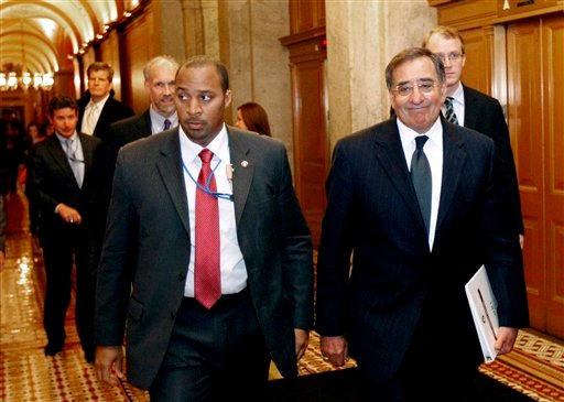 FILE - In this May 3, 2011 file photo, CIA Director Leon Panetta, right, leaves after briefing members of Congress on Capitol Hill in Washington.