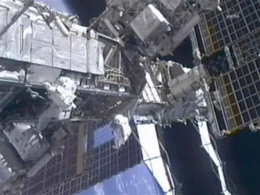 In this image from NASA television astronauts Mike Fincke, left, and Greg Chamitoff, make their way along the P3 Truss on the International Space Station as they make their way back to the quest airlock wrapping up the fourth spacewalk Friday morning.
