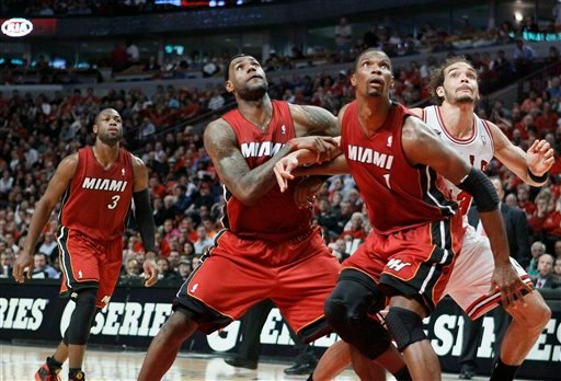 Chicago Bulls center Joakim Noah, right, gets boxed out by Miami Heat forwards LeBron James (6) and Chris Bosh (1) during the second quarter of Game 5 of the NBA basketball Eastern Conference finals Thursday, May 26, 2011, in Chicago.