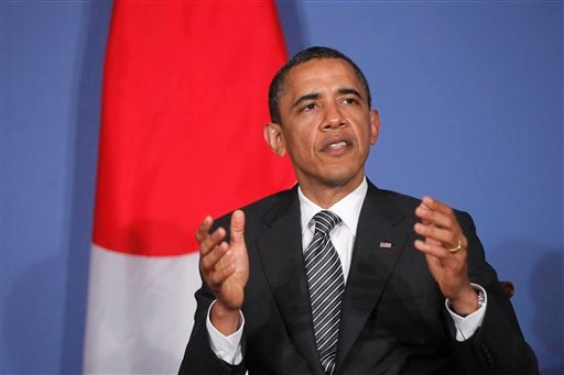 President Barack Obama speaks to reporters as he meets with Japan's Prime Minister Naoto Kan at the G8 summit in Deauville, France, Thursday, May 26, 2011.