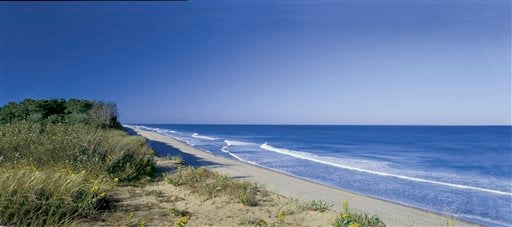 In this file photo provided by the Cape Cod Chamber of Commerce, Coast Guard Beach is shown in Cape Cod, Mass.