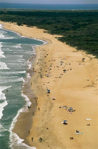 In this file photo provided by the Outer Banks Visitors Bureau, Buxton Beach is shown in the Outer Banks of North Carolina.
