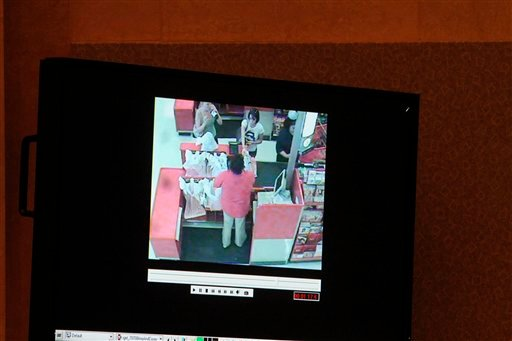 Casey Anthony is seen shopping in a detail of a surveillance video shown as evidence in the Casey Anthony trial is shown on a monitor at the Orange County Courthouse, Friday, May 27, 2011 in Orlando, Fla.