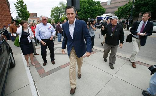 Former Massachsetts Gov. Mitt Romney makes his way to his vehicle after speaking at the Mediacom 2012 Presidential Candidate Series, Friday, May 27, 2011, in Des Moines, Iowa.