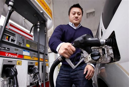 Vu To finishes filling his gas tank at a Shell gas station where, at $4.199 a gallon, the price is among the highest in the area, Tuesday, April 26, 2011, in the Seattle suburb of Bellevue, Wash.