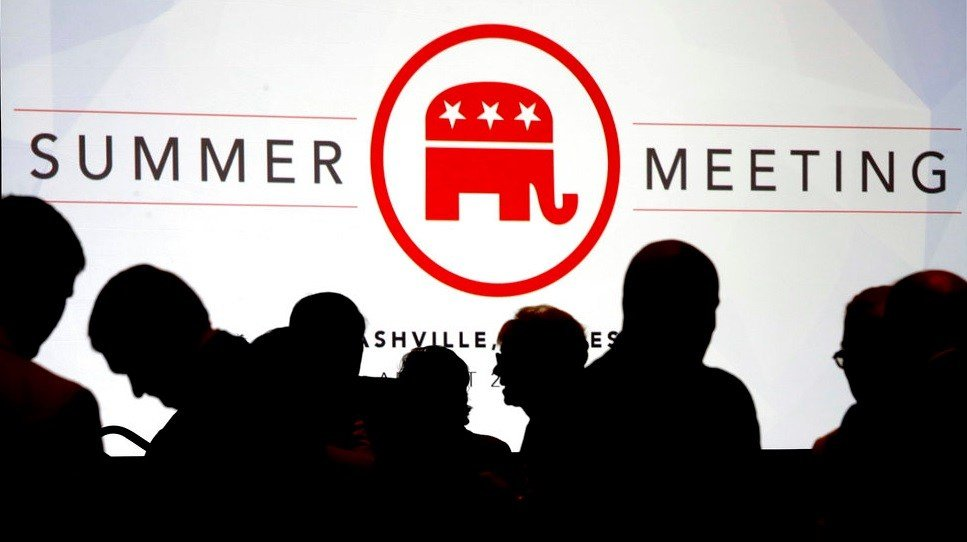 People talk before the start of the meeting of the standing committee on rules at the Republican National Committee summer meeting.