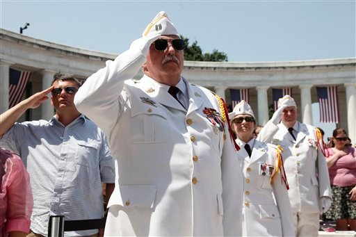"Veterans of Foreign Wars honor guards salute during the playing of ""Taps"" as President Barack Obama participates in the Memorial Day ceremony at Arlington National Cemetery Monday, May 30, 2011."